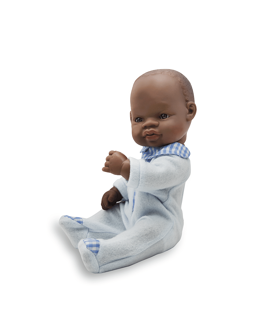 Newborn African boy doll in sleepwear