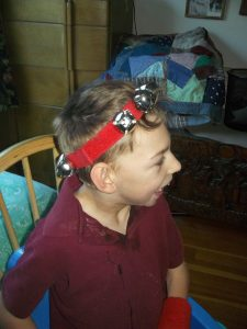 boy wearing jingle band crown