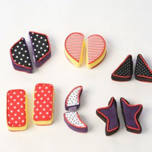 Match halves to complete tactile shapes