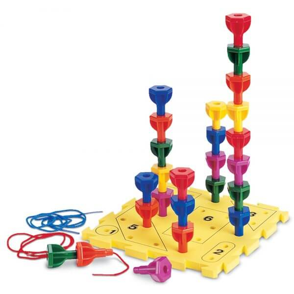 Peg play develops eye-hand coordination