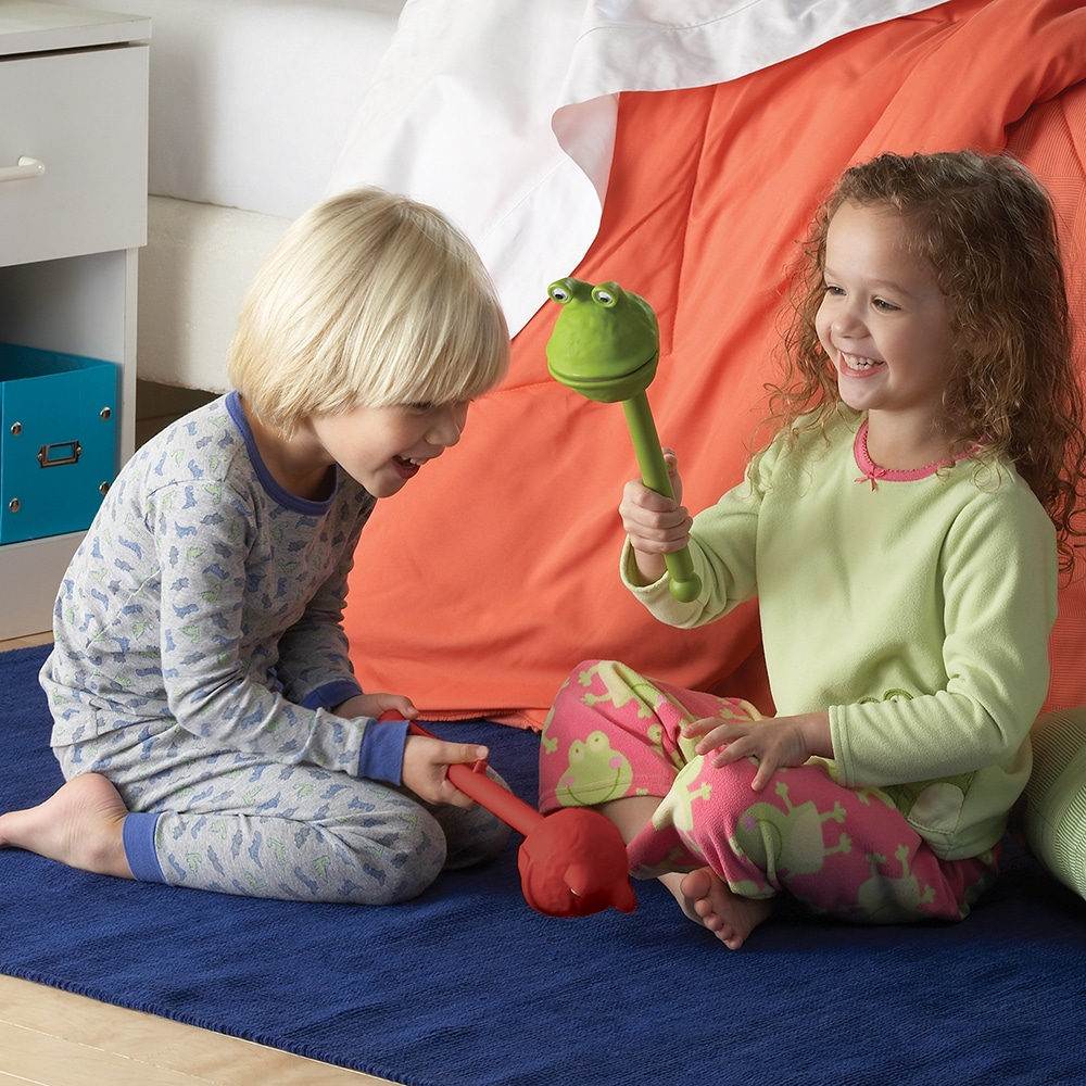 two children playing with Monster puppets-on-a-stick
