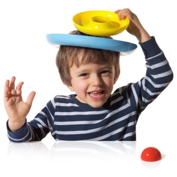 boy balancing concentric circles on his head