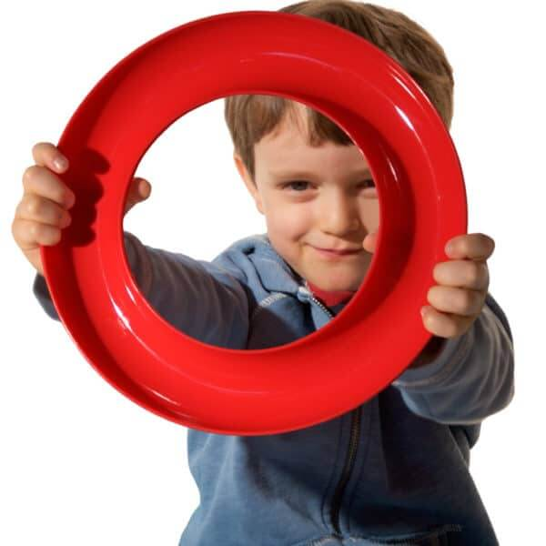 boy using large circle as steering wheel