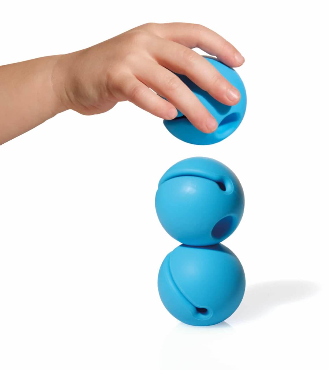child stacking 2-inch silicone balls