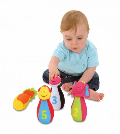 Toddler setting up cloth bowling pins