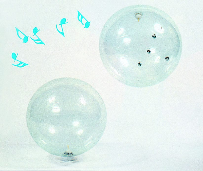 Large transparent ball with jingle bells inside