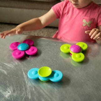 Whirly Squigz stick to surfaces and spin